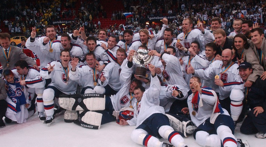 Slovakia's players pose with the trophy after they beat Russia in the final of the  World Ice Hockey Championship  in Gothenburg, Saturday, May 11, 2002. (AP Photo/Dusan Vranic)
