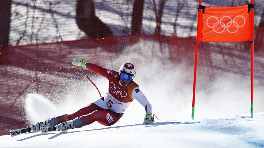 Switzerland's Beat Feuz skis during the men's downhill at the 2018 Winter Olympics in Jeongseon, South Korea, Thursday, Feb. 15, 2018. (AP Photo/Patrick Semansky)