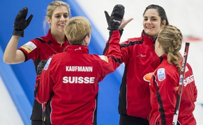 Skip Binia Feltscher of Switzerland, 2nd right, reacts with Christine Urech of Switzerland, left, Franziska Kaufmann of Switzerland, 2nd left, and Irene Schori of Switzerland, right, as they compete against Finland during the women's qualification round match of the European Curling Championships 2014, at the Palladium Ice Arena, in Champery, Switzerland, Saturday, November 22, 2014. (KEYSTONE/Jean-Christophe Bott)