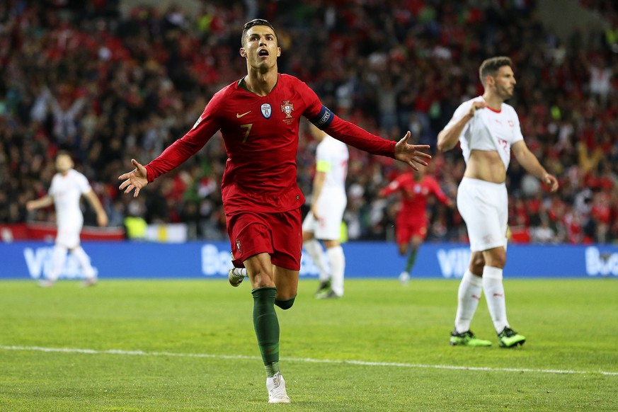 epa07628542 Portugal's Cristiano Ronaldo celebrates after scoring a goal during the UEFA Nations League semi final soccer match between Portugal and Switzerland at Dragao stadium in Porto, Portugal, 05 June 2019.  EPA/JOSE COELHO