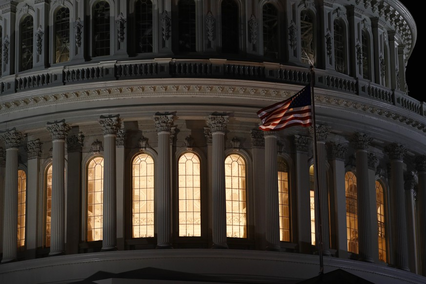 Light shines from inside the U.S. Capitol dome in Washington, late Tuesday, Nov. 12, 2019. The public impeachment inquiry hearings set to begin Wednesday will pit a Democratic attorney who built his reputation as a federal mob and securities fraud prosecutor against a GOP House Oversight investigator who helped steer some of the most notable probes of the Obama administration. (AP Photo/Patrick Semansky)