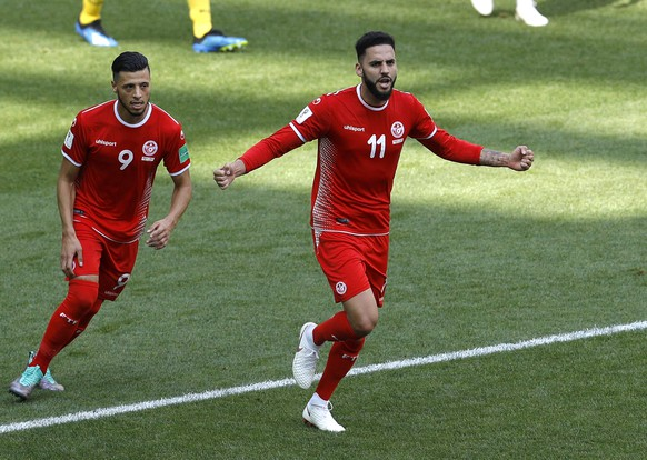 Tunisia's Dylan Bronn, right, scores his side's opening goal against Belgium as Tunisia's Anice Badri follows him during the group G match between Belgium and Tunisia at the 2018 soccer World Cup in the Spartak Stadium in Moscow, Russia, Saturday, June 23, 2018. (AP Photo/Victor Caivano)