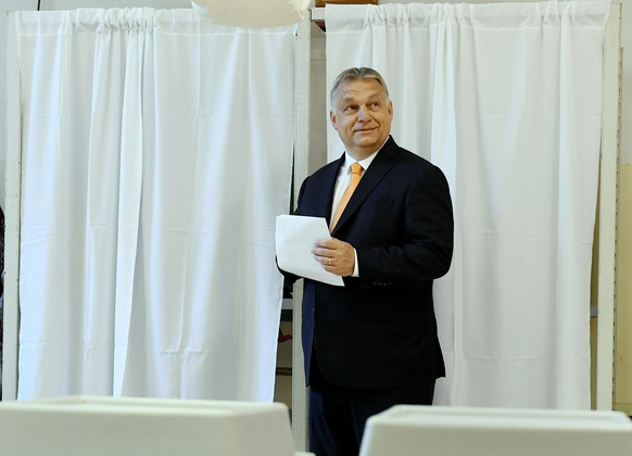 Hungarian Prime Minister Viktor Orban smiles before casting his vote at a polling station in Budapest, Hungary, Sunday, May 26, 2019. The European Parliament election is held by member countries of the European Union (EU) from 23 to 26 May 2019. (Szilard Koszticsak/MTI via AP)