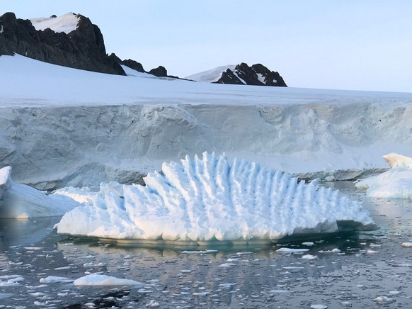 This January 2018 photo provided by researcher Andrew Shepherd shows an unusual iceberg near the Rothera Research Station on the Antarctic Peninsula. In a study released Wednesday, June 13, 2018, an international team of ice experts said the melting of Antarctica is accelerating at an alarming rate, with about 3 trillion tons of ice disappearing since 1992. (Andrew Shepherd/University of Leeds via AP)