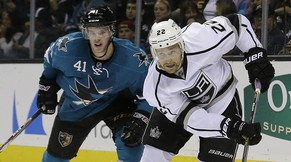 Los Angeles Kings center Trevor Lewis (22) skates in front of San Jose Sharks defenseman Mirco Mueller (41), from Switzerland, during the second period of an NHL preseason hockey game in San Jose, Calif., Tuesday, Sept. 30, 2014. (AP Photo/Jeff Chiu)