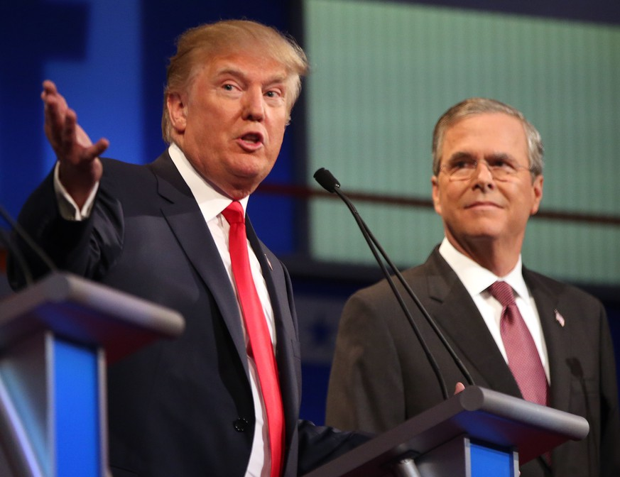FILE - In this Aug. 6, 2015, file photo, Republican presidential candidates Donald Trump and Jeb Bush participate in the first Republican presidential debate at the Quicken Loans Arena in Cleveland. Presidential debates were big draws and big business for the networks that presented them in 2015 _ at least, when Donald Trump was involved. The first Republican debate was watched by 24 million viewers, the highest-rated broadcast in Fox News Channel's history.  (AP Photo/Andrew Harnik, File)