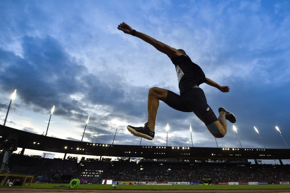 Benjamin Compaore from France compete in the men's triple jump final, at the third day of the European Athletics Championships in the Letzigrund Stadium in Zurich, Switzerland, Thursday, August 14, 2014. (KEYSTONE/Ennio Leanza)