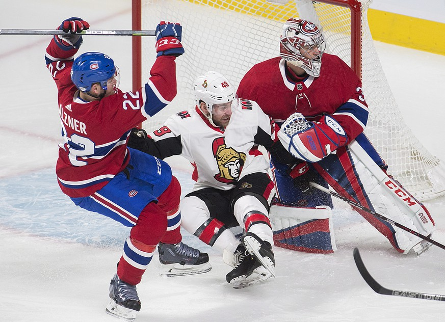 Ottawa Senators left wing Christopher DiDomenico (49) is sandwiched between Montreal Canadiens goaltender Carey Price (31) and defenseman Karl Alzner (22) during first-period NHL hockey game action in Montreal, Sunday, Feb. 4, 2018. (Graham Hughes/The Canadian Press via AP)
