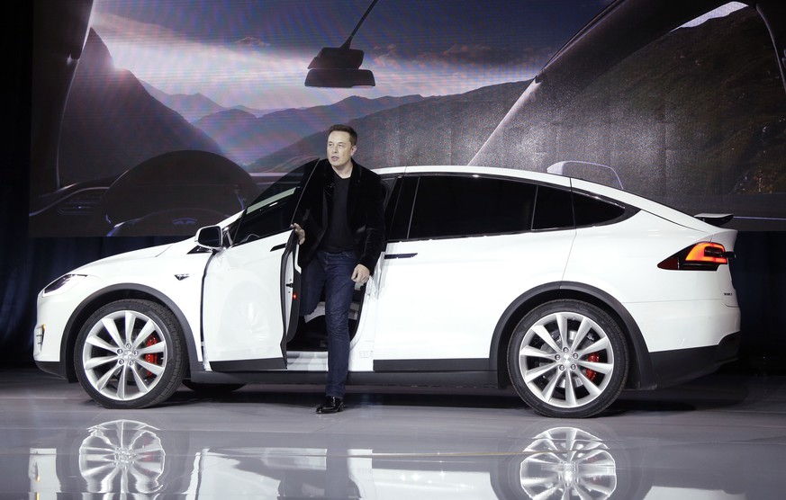 FILE - In this Sept. 29, 2015, file photo, Elon Musk, CEO of Tesla Motors Inc., introduces the Model X car at the company's headquarters in Fremont, Calif. Tesla Motors customers will get enhanced radar and other features in an over-the-air software update that starts Wednesday, Sept. 21, 2016. The update makes the Model S sedan and Model X SUV more reliant on radar than cameras when driving in Tesla's semi-autonomous Autopilot mode. Teslas made after October 2014 have radar. (AP Photo/Marcio Jose Sanchez, File)