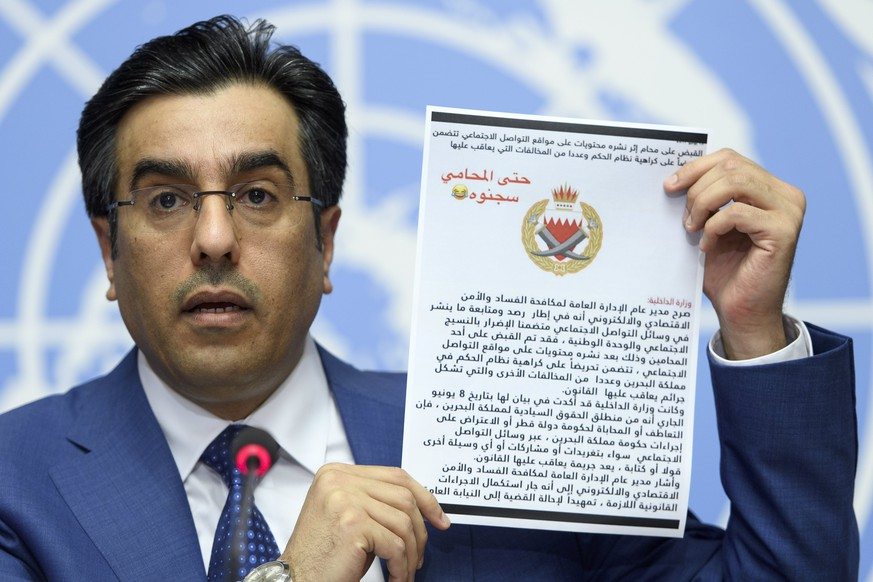 epa06031248 Ali bin Smaikh Al-Marri, Chairman of the Qatari National Human Rights Committee, holds an untranslated document written in arabic as he speaks during a press conference about the illegal blockade against Qatar and its impact on human rights of citizens of GCC Countries., at the European headquarters of the United Nations, in Geneva, Switzerland, 16 June 2017.  EPA/MARTIAL TREZZINI