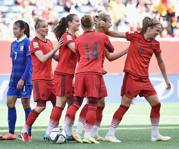 WINNIPEG, MB - JUNE 15:  Lena Petermann of Germany celebrates with team mates as she heads the third goal during the FIFA Women's World Cup Canada 2015 Group B match between Thailand and Germany at Winnipeg Stadium on June 15, 2015 in Winnipeg, Canada.  (Photo by Dennis Grombkowski/Bongarts/Getty Images)