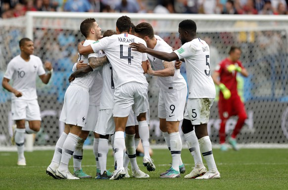 France's Antoine Griezmann celebrates with teammates after scoring his side's second goal during the quarterfinal match between Uruguay and France at the 2018 soccer World Cup in the Nizhny Novgorod Stadium, in Nizhny Novgorod, Russia, Friday, July 6, 2018. (AP Photo/Ricardo Mazalan)