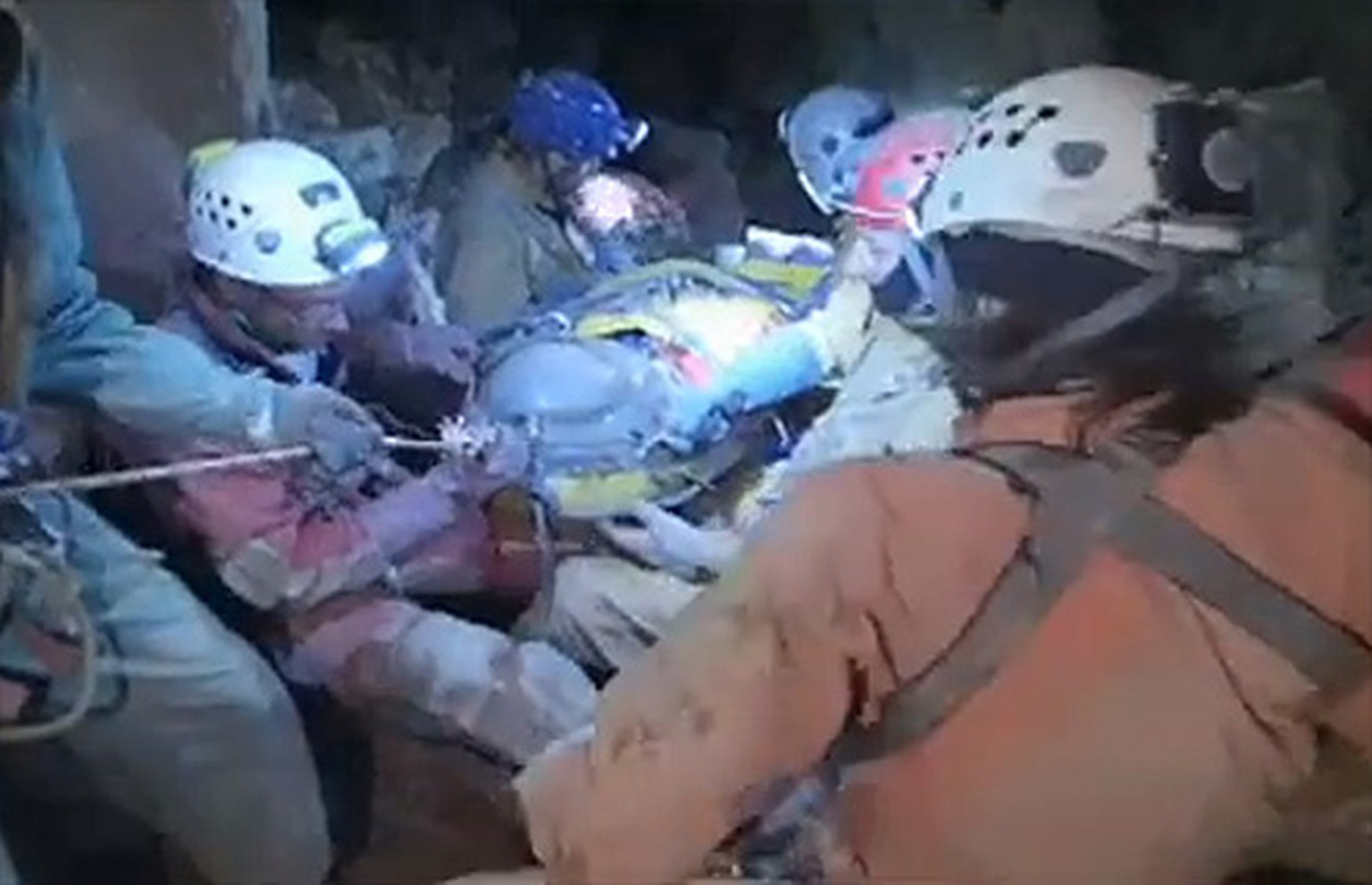 Rescuers help injured researcher Johann Westhauser inside the Riesending cave in Untersberg, south of Munich in this still image taken from video from a camera mounted on the helmet of a rescuer released by Bavaria's mountain rescue team