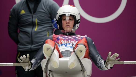 Martina Kocher of Switzerland prepares to start her first run during the women's singles luge competition at the 2014 Winter Olympics, Monday, Feb. 10, 2014, in Krasnaya Polyana, Russia. (AP Photo/Jae C. Hong)