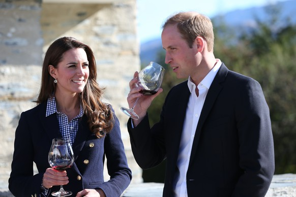 Britain's Prince William, right, and his wife Kate, Duchess of Cambridge, prepare to sample a wine during a visit to Amsfield Winery in Queenstown, New Zealand, Sunday, April 13, 2014. The royal couple are on an official visit to New Zealand. (AP Photo/Fiona Goodall, Pool)