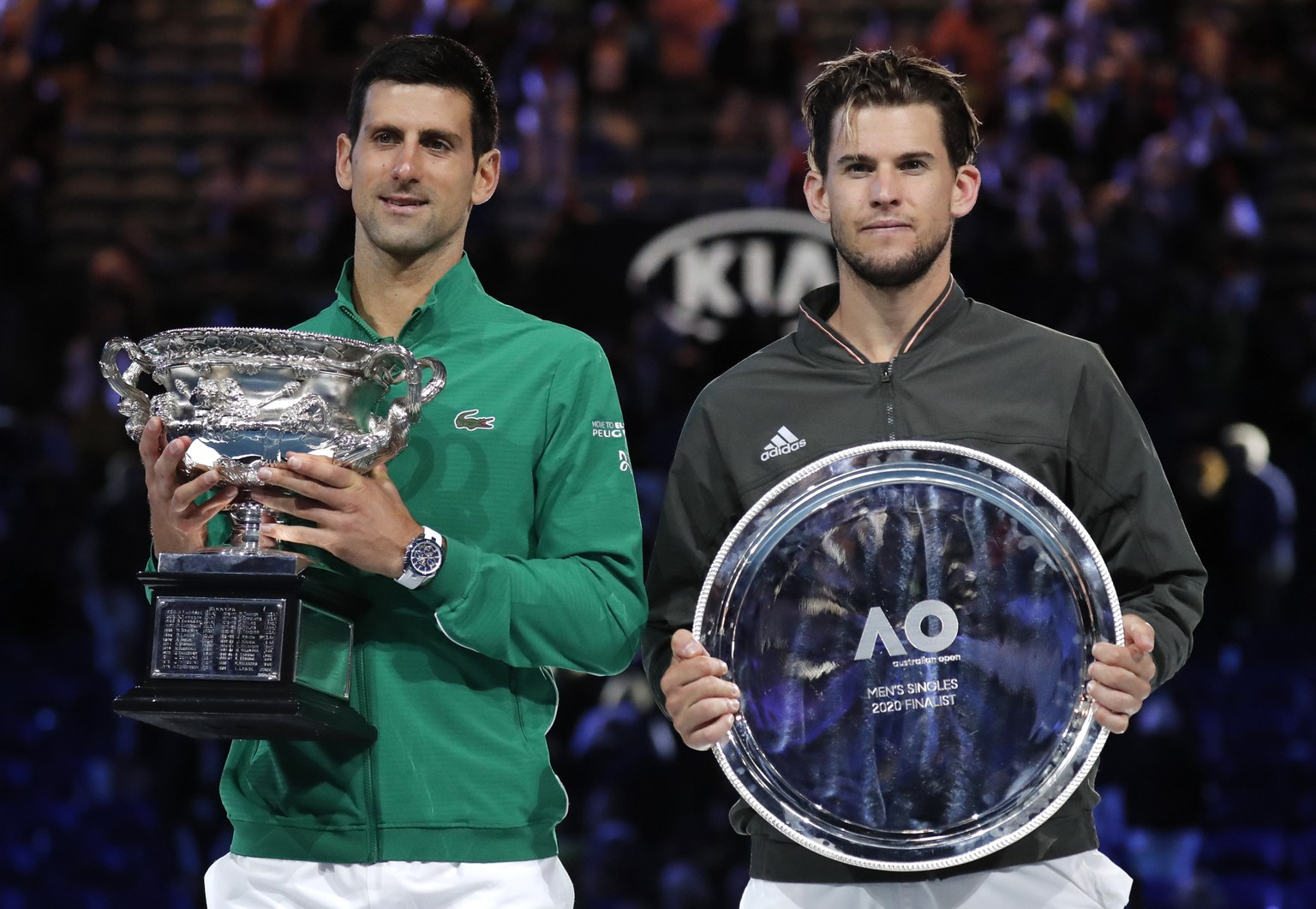 Serbia's Novak Djokovic, left, holds the Norman Brooks Challenge Cup after defeating Austria's Dominic Thiem in the men's singles final of the Australian Open tennis championship in Melbourne, Australia, early Monday, Feb. 3, 2020. (AP Photo/Lee Jin-man) Dominic Thiem,Novak Djokovic