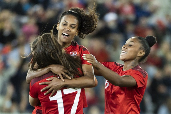Swiss Svenja Foelmi, left, celebrates with Coumba Sow, center, and Sally Julini, after scoring to 4:1, as Lithuania's Monika Piesliakaite, left, is looking on, during the FIFA Women's World Cup 2023 qualifying round group G soccer match between Switzerland and Lithuania at the Stockhorn Arena in Thun, Switzerland, on Friday, September 17, 2021. (KEYSTONE/Alessandro della Valle)