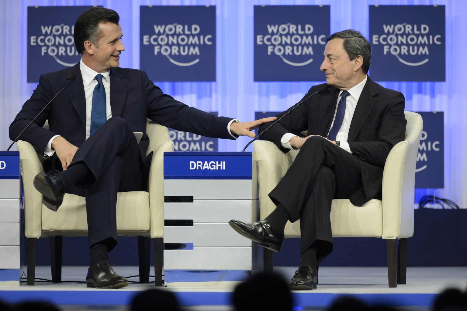 Mario Draghi, right, President of the European Central Bank, ECB, speaks with Philipp M. Hildebrand, left, vice-chairman of BlackRock and former Swiss National Bank chairman, during a panel session on the third day of the 44th Annual Meeting of the World Economic Forum, WEF, in Davos, Switzerland, Friday, January 24, 2014. The overarching theme of the Meeting, which take place from 22 to 25 January, is