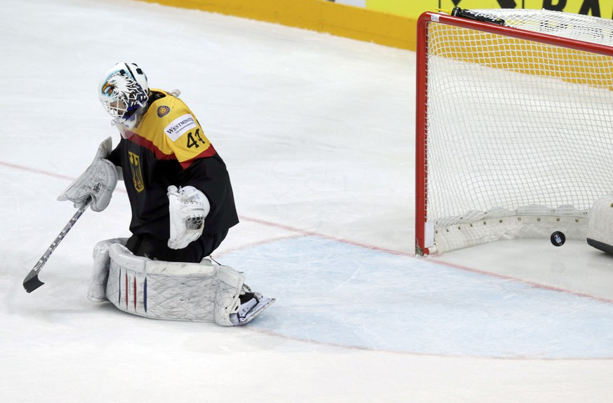 Germany's goaltender Dennis Endras fails to save a goal by Austria's Thomas Raffl (not pictured) during their Ice Hockey World Championship game at the O2 arena in Prague, Czech Republic May 11, 2015. REUTERS/David W Cerny