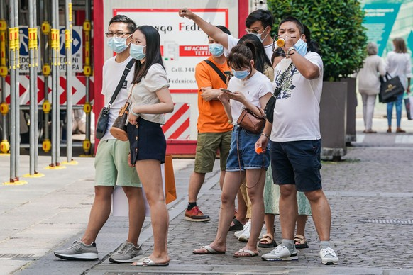 epa09275750 Asian tourists in downtown Turin, northern Italy, 16 June 2021. The Italian government is significantly easing its COVID-19-linked restrictions after months of restrictions due to the coronavirus pandemic and starting to welcome back vaccinated foreign tourists to Italy.  EPA/TINO ROMANO