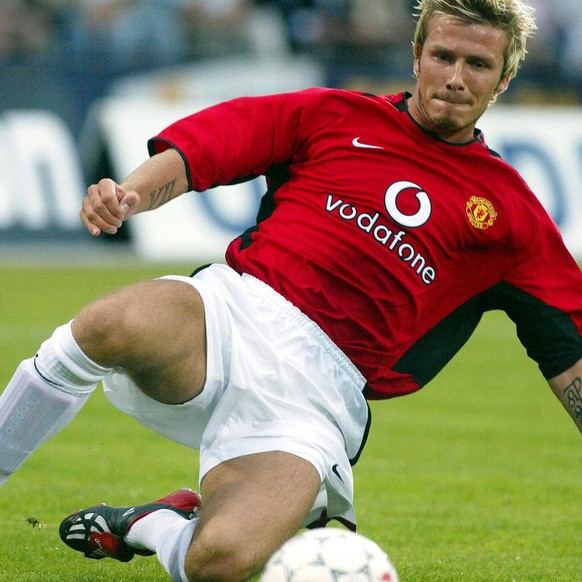epa03703370 (FILE) A file picture dated 06 August 2002 shows Manchester United's English midfielder David Beckham in action during a friendly soccer match against Aarhus FC in Aarhus, Denmark. Former England captain David Beckham is to announce his retirement from professional soccer at the end of the season, the 38-year-old midfielder of Paris Saint Germain announced on 16 May 2013.  EPA/PALLE HEDEMANN DENMARK OUT