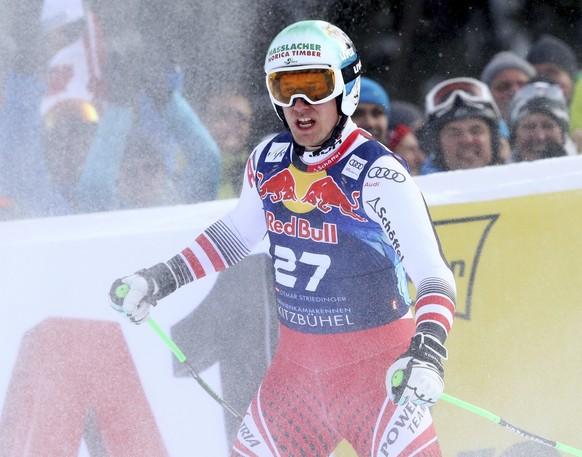 Austria's Otmar Striedinger reacts at the finish area of an alpine ski, men's World Cup downhill, in Kitzbuehel, Austria, Friday, Jan. 25, 2019. (AP Photo/Alessandro Trovati)