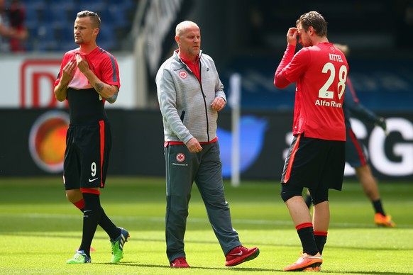 FRANKFURT AM MAIN, GERMANY - MAY 09:  Head coach Thomas Schaaf of Frankfurt walks past Haris Seferovic (L) and Marco Russ prior to the Bundesliga match between Eintracht Frankfurt and 1899 Hoffenheim at Commerzbank-Arena on May 9, 2015 in Frankfurt am Main, Germany.  (Photo by Alex Grimm/Bongarts/Getty Images)