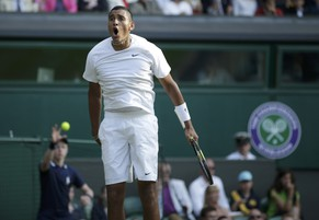 Nick Kyrgios of Australia reacts to breaking serve during his men's singles tennis match against Rafael Nadal of Spain at the Wimbledon Tennis Championships, in London July 1, 2014.            REUTERS/Max Rossi (BRITAIN  - Tags: SPORT TENNIS TPX IMAGES OF THE DAY)