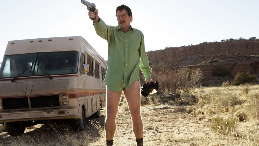 This image released by AMC shows Walter White, played by Bryan Cranston, next to the Winnebago he uses as a mobile meth lab in the pilot episode of