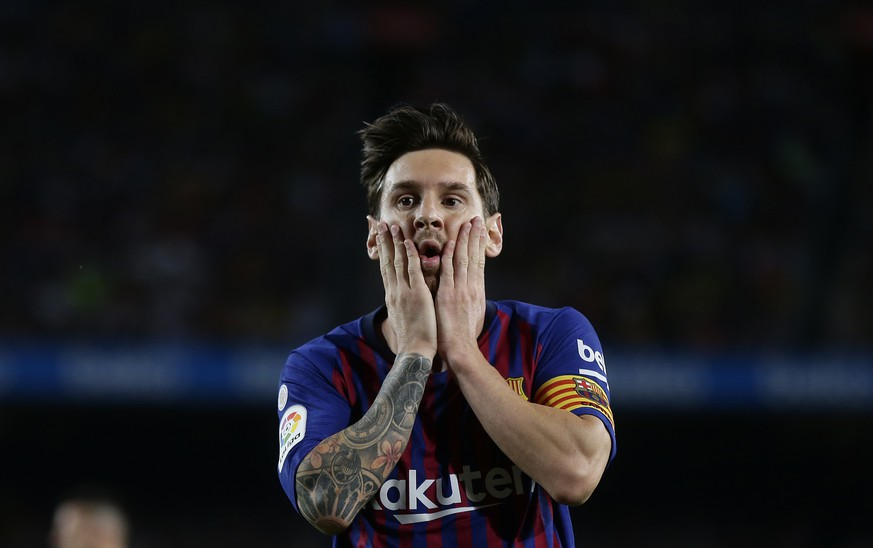 FC Barcelona's Lionel Messi reacts after missing an opportunity during the Spanish La Liga soccer match between FC Barcelona and Girona at the Camp Nou stadium in Barcelona, Spain, Sunday, Sept. 23, 2018. (AP Photo/Manu Fernandez)