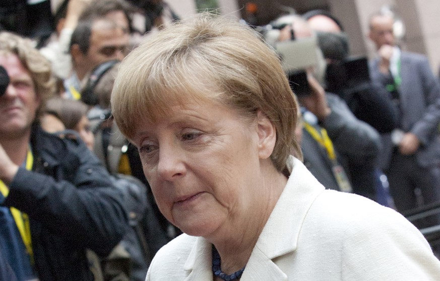 German Chancellor Angela Merkel, center, arrives for a meeting of eurozone heads of state at the EU Council building in Brussels on Sunday, July 12, 2015. Greece has another chance Sunday to convince skeptical European creditors that it can be trusted to enact wide-ranging economic reforms which would safeguard its future in the common euro currency. (AP Photo/Francois Walschaerts)