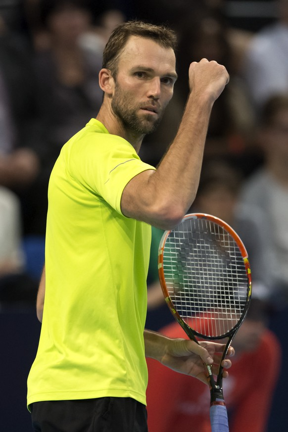 Croatia's Ivo Karlovic cheers during his semifinal match against Switzerland's Roger Federer at the Swiss Indoors tennis tournament at the St. Jakobshalle in Basel, Switzerland, on Saturday, October 25, 2014. (KEYSTONE/Georgios Kefalas)
