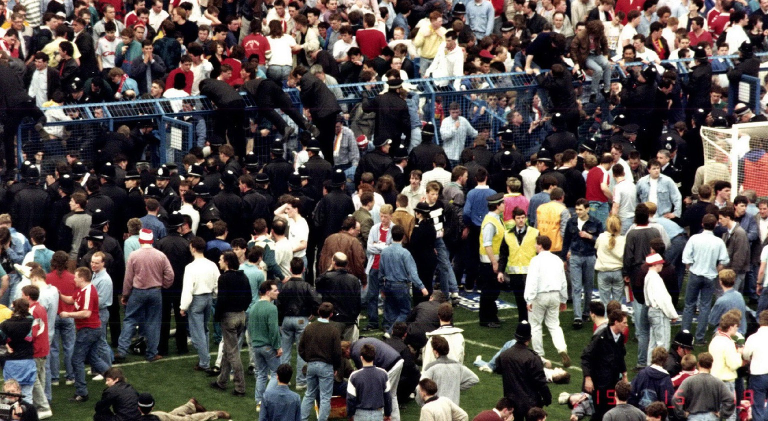 "epa05277858 A handout photograph - evidence number SYP000151090021 – made available by the Hillsborough Inquest on 26 April 2016 showing a photograph, shown in open court as part of the inquests' proceedings, of the Leppings Lane terrace at the Hillsborough Stadium, Sheffield, England, on 15 April 1989.  A human crush caused the deaths of 96 people and injured 766 others, at a FA Cup semi final soccer match between Liverpool and Nottingham Forest at Hillsborough Stadium, Sheffield, England, on 15 April 1989.  EPA/HILLSBOROUGH INQUEST / HANDOUT MADATORY CREDIT: The Hillsborough Inquests – www.hillsboroughinquests.independent.gov.uk"" HANDOUT EDITORIAL USE ONLY/NO SALES/NO ARCHIVES"
