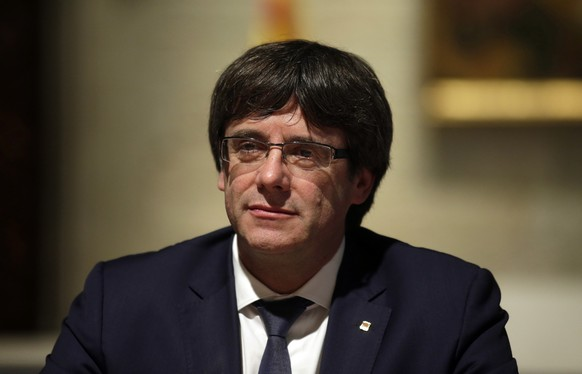 Catalan president Carles Puigdemont looks on during a meeting at the Generalitat Palace in Barcelona, Spain, Friday, Oct. 6, 2017. Catalan president Carles Puigdemont has asked to address the regional parliament next week as his government faced challenges on delivering on its pledge to declare independence for the northeastern region. (AP Photo/Manu Fernandez)