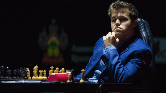 Norway's Magnus Carlsen, currently the top ranked chess player in the world, looks on as he plays his 11th game against India's former World Champion Vishwanathan Anand, not seen, at the FIDE World Chess Championship Match in Sochi, Russia, Sunday, Nov. 23, 2014. (AP Photo/Artur Lebedev)