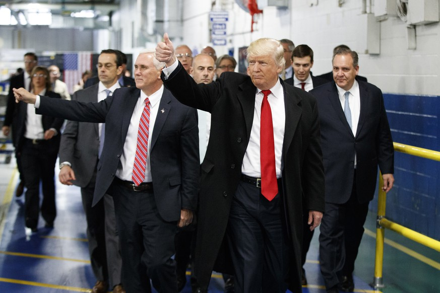 FILE - In this Thursday, Dec. 1, 2016 file photo, President-elect Donald Trump and Vice President-elect Mike Pence wave as they visit to Carrier factory, in Indianapolis, Ind. Trump is slamming a union leader who criticized his deal to discourage air conditioner manufacturer Carrier Corp. from closing an Indiana factory and moving its jobs to Mexico. Trump tweeted Wednesday evening, Dec. 7, 2016: