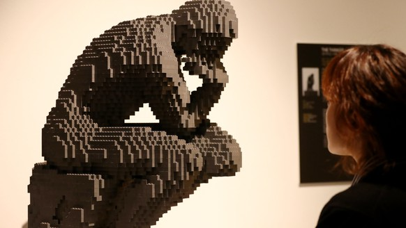 epa06260580 A visitor looks at 'The Thinker' made of LEGO toy bricks at US artist Nathan Sawaya's 'The Art of the Brick' exhibition at an art center in Seoul, South Korea, 12 October 2017.  EPA/YONHAP SOUTH KOREA OUT