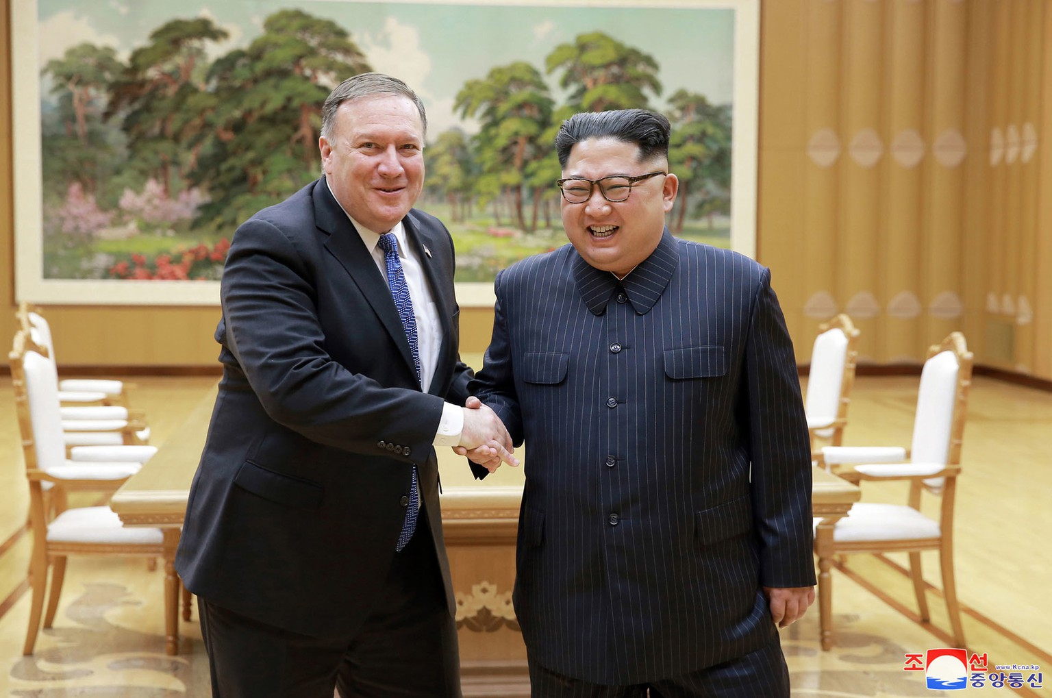 FILE - In this May 9, 2018, file photo provided by the North Korean government, U.S. Secretary of State Mike Pompeo, left, shakes hands with North Korean leader Kim Jong Un during a meeting at Workers' Party of Korea headquarters in Pyongyang, North Korea. After a few months of rapprochement, North Korea abruptly called off scheduled high-level talks with South Korea on Wednesday, May 16, 2018,  and warned the U.S. that a planned summit with President Donald Trump could be at risk. Independent journalists were not given access to cover the event depicted in this image distributed by the North Korean government. The content of this image is as provided and cannot be independently verified. Korean language watermark on image as provided by source reads:
