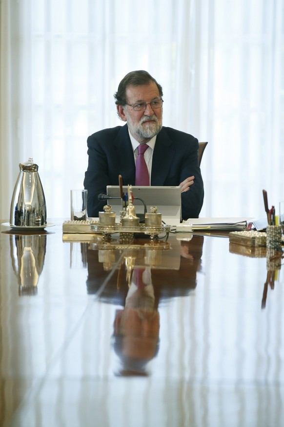epa06147257 Spanish Prime Minister Mariano Rajoy chairs an extraordinary Spanish cabinet meeting held in Madrid, Spain, 16 August 2017. The Cabinet discuss among others issues, the security staff strike action at the Barcelona El Prat airport. Workers of airport's security guards at Barcelona El Prat decided to continue with their strike after there was no agreement with the company. Barcelona-El Prat airport's security workers from Eulen have called for an indefinite strike as of 14 August to demand improvements in their labour and wage conditions. Spanish Government has decided to deploy Civil Guards at the airport controls to guarantee security.  EPA/FERNANDO ALVARADO