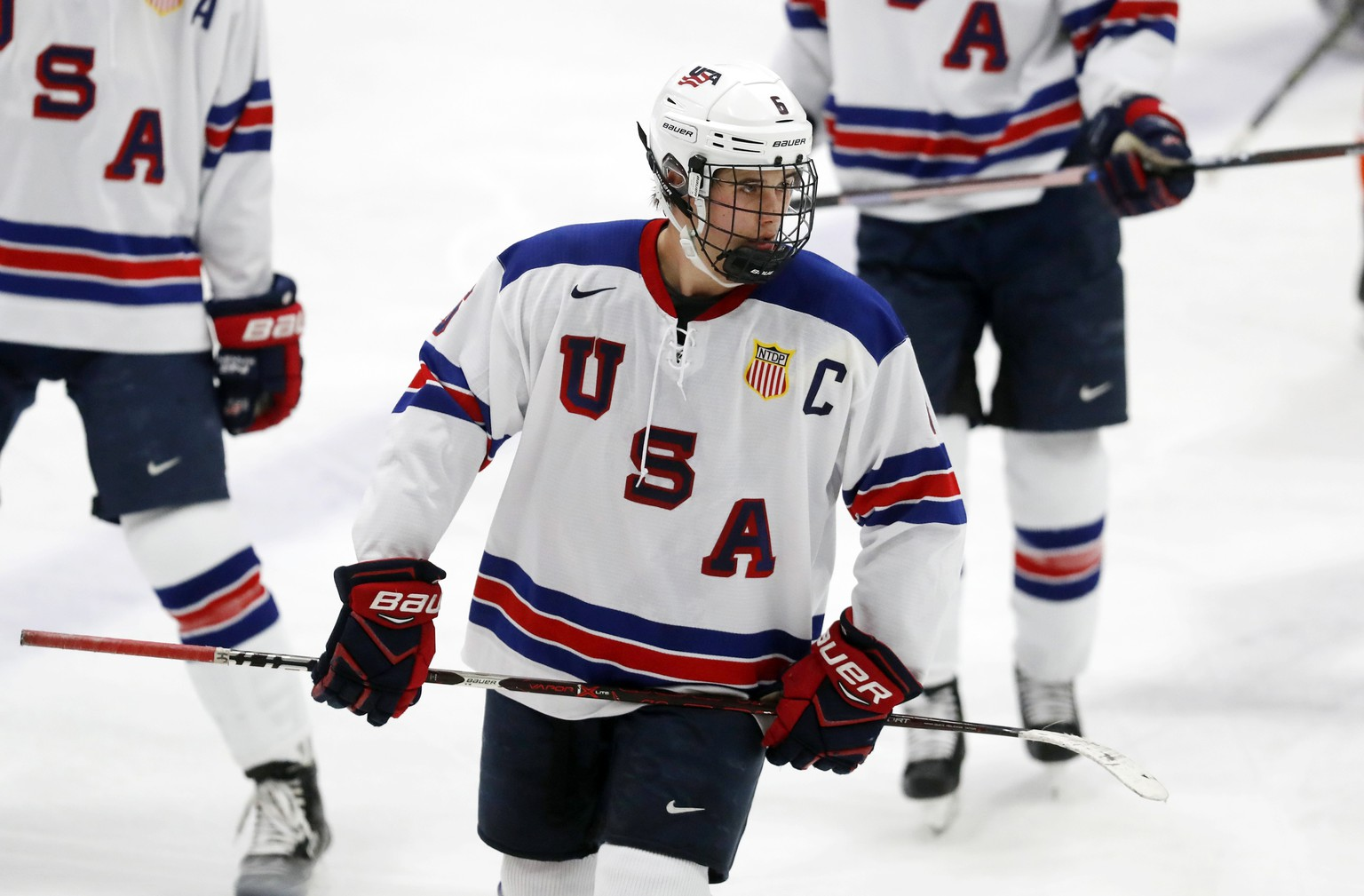 In this Wednesday, Nov. 21, 2018, photo, Jack Hughes, expected to be a top pick in the next NHL hockey draft, plays against Bowling Green in Plymouth, Mich. USA Hockey has developed the nation's top players for more than two-plus decades, producing a quartet of No. 1 overall picks in the NHL draft, including Auston Matthews and Patrick Kane. Hughes may be next. (AP Photo/Carlos Osorio)