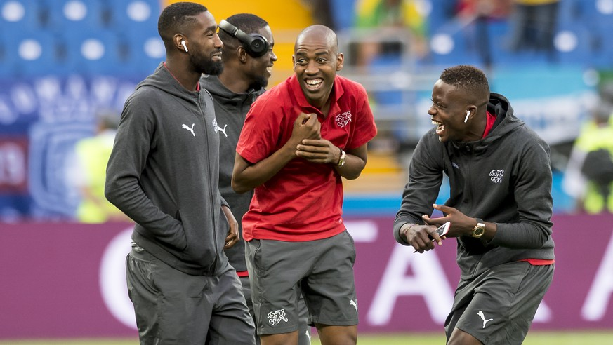 Switzerland's soccer players Johan Djourou, goalkeeper Yvon Landry Mvogo, Gelson Fernandes, and Denis Zakaria, from left to right, react before during the FIFA soccer World Cup 2018 group E match between Switzerland and Brazil at the Rostov Arena, in Rostov-on-Don, Russia, Sunday, June 17, 2018. (KEYSTONE/Laurent Gillieron)