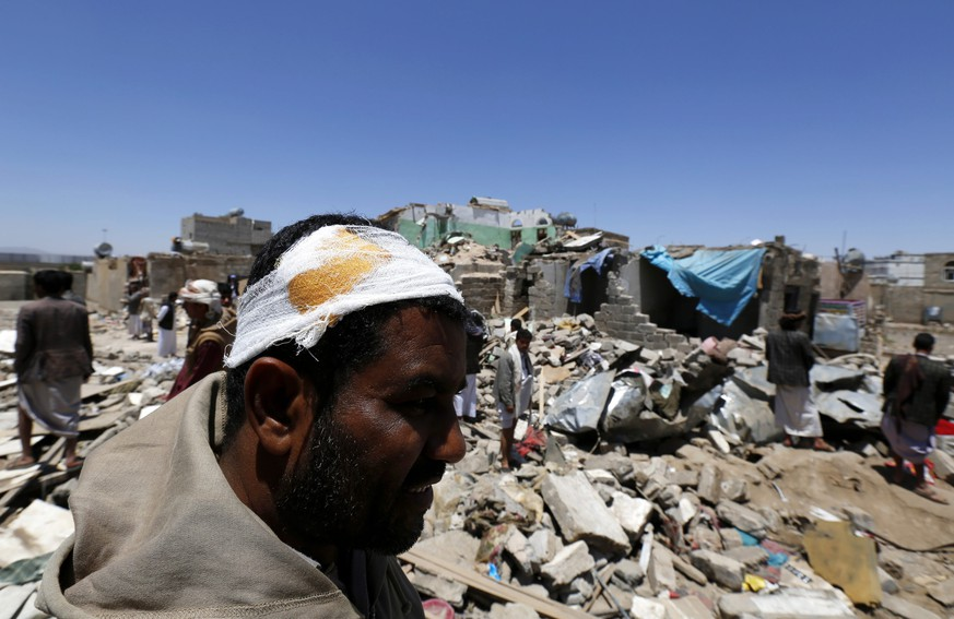 epa04685541 An injured man stands over the rubble of his house which was allegedly destroyed by an airstrike of the Saudi-led coalition targeting Houthi rebels' positions in Sana'a, Yemen, 29 March 2015. Media reports quoting local residents said the Saudi-led coalition jets pounded military facilities of Yemen's Houthi rebels in their northern stronghold of Saada on 29 March, in a conflict pitting Saudi Arabia against its regional rival Iran. Allied warplanes mounted a series of strikes against a major Houthi outpost in Saada where an arms depot and military vehicles were destroyed as a result, said residents in the area that borders Saudi Arabia.  EPA/YAHYA ARHAB