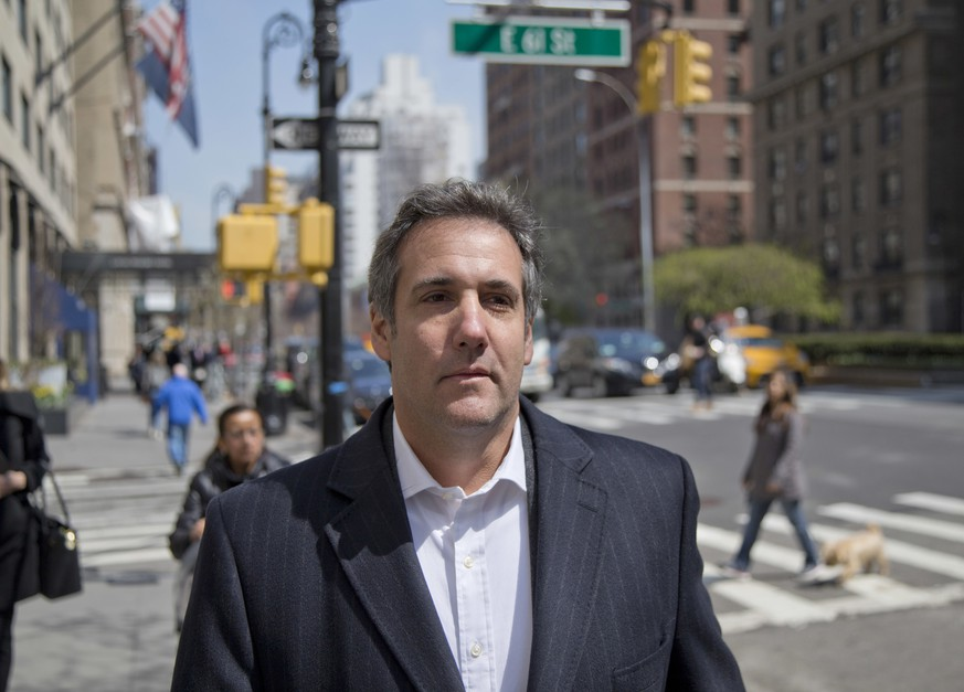 FILE - In this April 11, 2018, file photo, attorney Michael Cohen walks down the sidewalk in New York. Cohen, President Donald Trump's longtime personal lawyer who is under investigation by federal prosecutors in New York, said in his Twitter post Sunday, July 1, that he sat down for an interview with ABC News and his