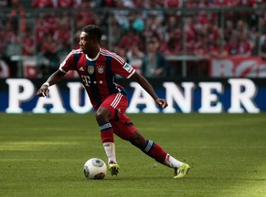 MUNICH, GERMANY - MAY 10:  David Alaba of Bayern Muenchen controls the ball during the Bundesliga match between Bayern Muenchen and VfB Stuttgart at Allianz Arena on May 10, 2014 in Munich, Germany.  (Photo by Adam Pretty/Bongarts/Getty Images)