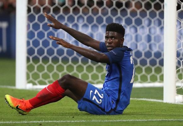 epa05413931 Samuel Umtiti of France reacts during the UEFA EURO 2016 semi final match between Germany and France at Stade Velodrome in Marseille, France, 07 July 2016.(RESTRICTIONS APPLY: For editorial news reporting purposes only. Not used for commercial or marketing purposes without prior written approval of UEFA. Images must appear as still images and must not emulate match action video footage. Photographs published in online publications (whether via the Internet or otherwise) shall have an interval of at least 20 seconds between the posting.)  EPA/OLIVER WEIKEN   EDITORIAL USE ONLY