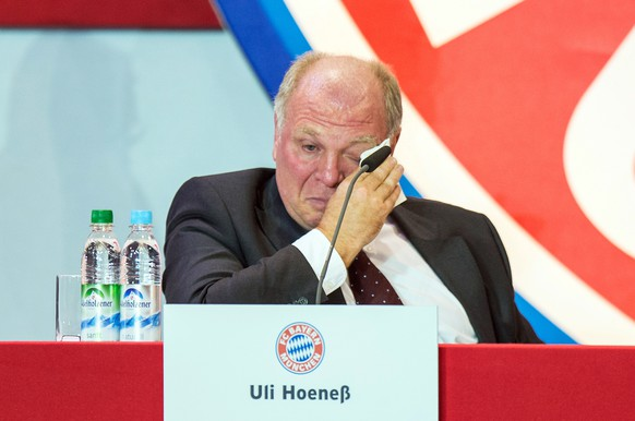"""Uli Hoeness, president of German soccer club FC Bayern Munich, cries during the annual club meeting in Munich, southern Germany, Wednesday, Nov. 13, 2013. Hoeness will have to go on trial next March to face tax evasion charges over a Swiss bank account, and Bayern has reaffirmed its backing for the 61-year-old following his """"outstanding services"""" to the club. (AP Photo/dpa, Marc Mueller)"""