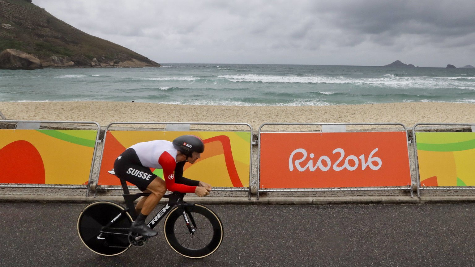 Cyclist Fabian Cancellara of Switzerland rides along Pontal beach during the men's individual time trial event at the 2016 Summer Olympics in Pontal beach, Rio de Janeiro, Brazil, Wednesday, Aug. 10, 2016. (AP Photo/Victor R. Caivano)