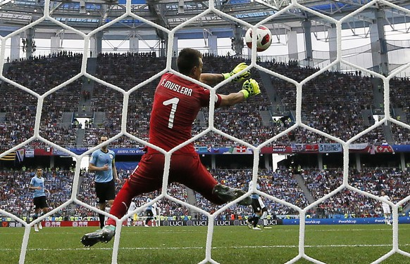 epa06868583 Goalkeeper Fernando Muslera of Uruguay can not stop the ball as France go 2-0 up during the FIFA World Cup 2018 quarter final soccer match between Uruguay and France in Nizhny Novgorod, Russia, 06 July 2018.