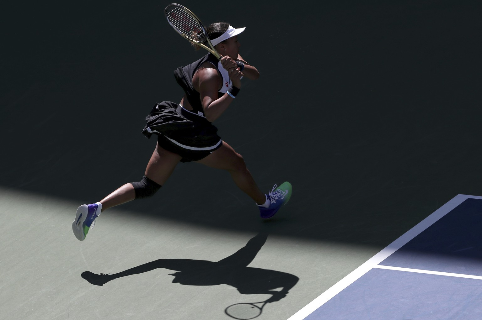 Naomi Osaka, of Japan, returns a shot to Magda Linette, of Poland, during the second round of the US Open tennis championships Thursday, Aug. 29, 2019, in New York. (AP Photo/Eduardo Munoz Alvarez)