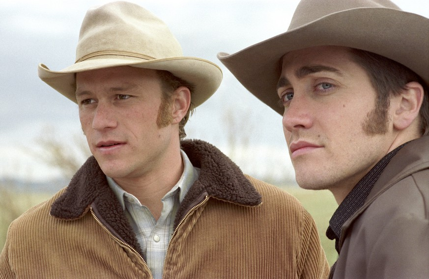 In this photo originally provided by Focus Features, Ennis Del Mar, left, played by Heath Ledger and ake Gyllenhaal in the role of  Jack Twist, are two cowboys from very different backgrounds who meet and fall in love while working together in
